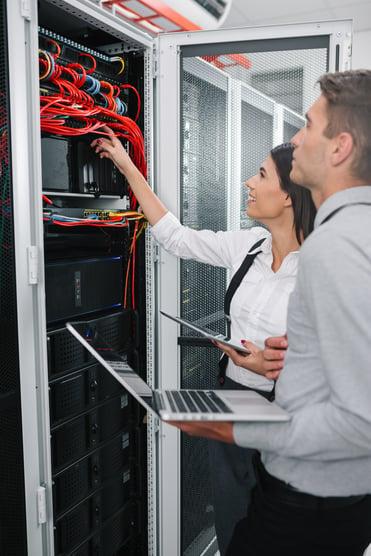 Businesswomen and businessman assessing electrics